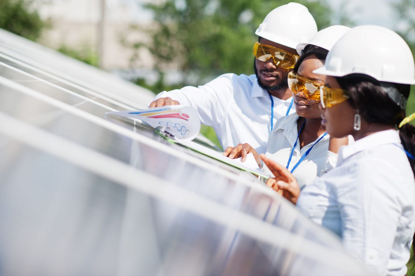 Photo of solar power engineers. The U.S. Trade and Development Agency awarded a grant to Nigeria's EM-ONE Energy Solutions Limited for a feasibility study that will strengthen healthcare delivery in rural and underserved regions of Nigeria through solar minigrid systems.