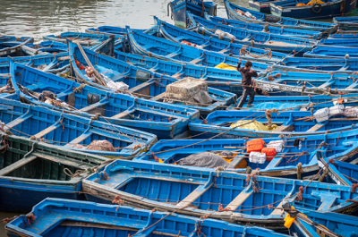 Photo of blue fishing boats in Morocco