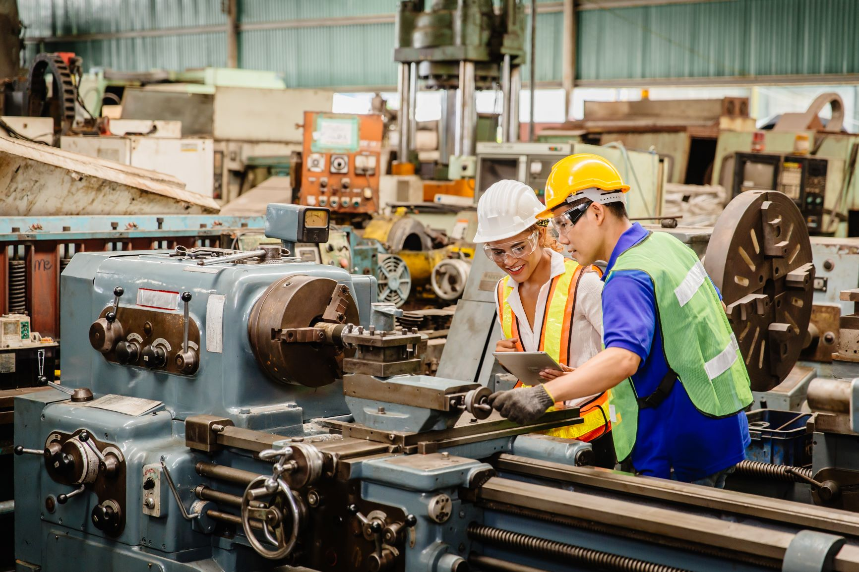 Photo of factory workers making rail crossing equipment