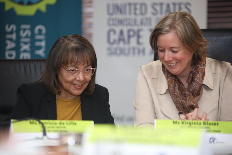 Executive Mayor Patricia de Lille (left) and U.S. Consul General Virginia Blaser sign USTDA's grant