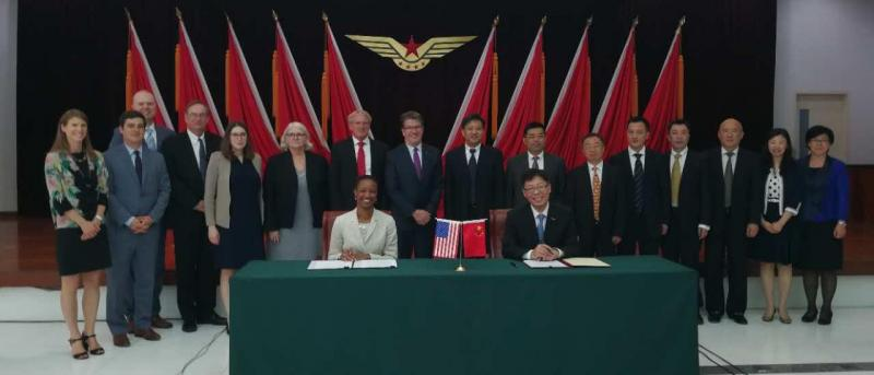 Enoh T. Ebong, Acting Director, USTDA and Deputy Administrator Deputy Administrator Wang Zhiqing, CAAC sign a grant supporting the U.S.-China Aviation Cooperation Program