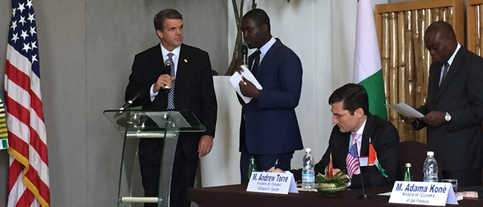 USTDA's Thomas R. Hardy announces the project in Cote d'Ivoire as part of a President's Advisory Council on Doing Business in Africa visit