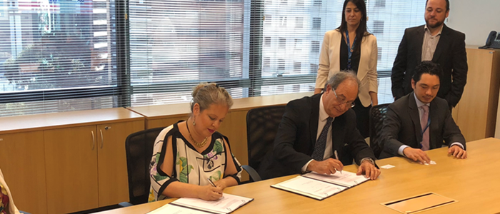 USTDA's Country Manager for Brazil, Gabrielle Mandel (center, left), signs the grant with Mr. Carlos Ribeiro, Operations Director, ISA CTEEP
