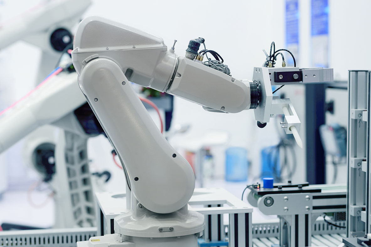 An image of a robotic arm in a lab or factory